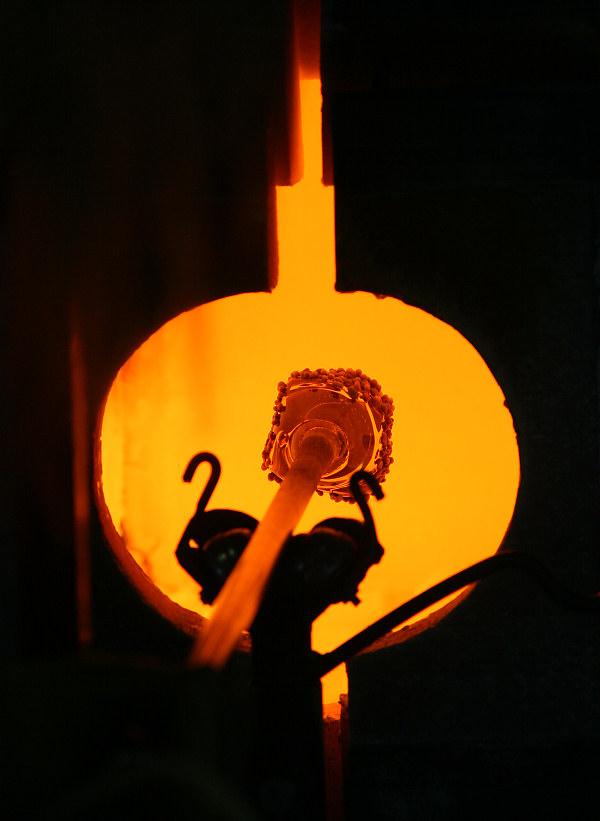 melting the colored glass in the Glory Hole furnace